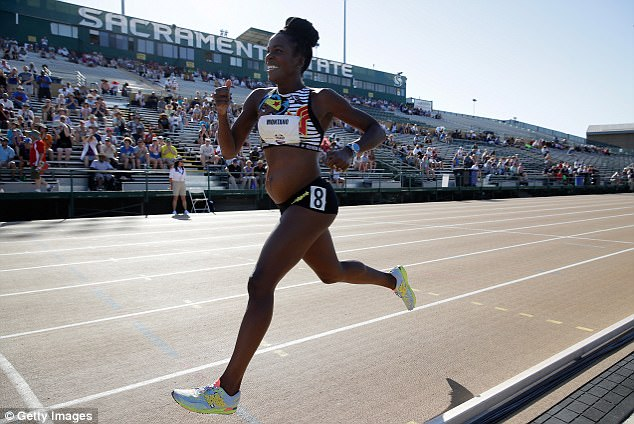 Track star runs in national race five months pregnant
