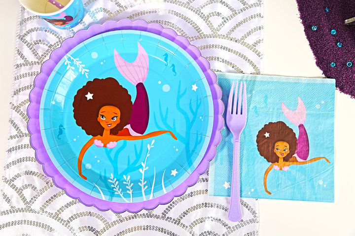 Mom creates black mermaid character on party supplies to remedy lack of color