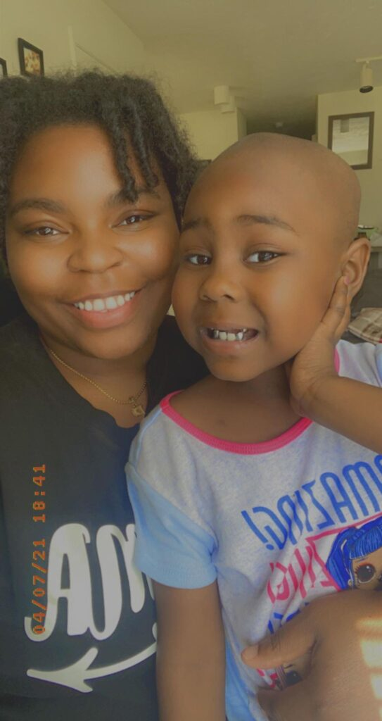 Tyesha Rodgers and her daughter Ta'Niyla smile for a selfie