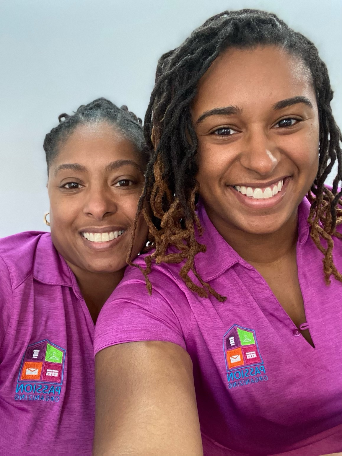 Alexia Ford and her daughter smile for a selfie in matching purple shirts donning the Passion Cleaning logo
